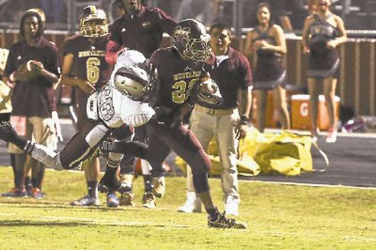 Magnolia West's Adrian Thomas carries the ball against Magnolia in last week's 20-0 victory. Thomas, a 160-pound sophomore, was chosen The Courier's Montgomery County Player of the Week.