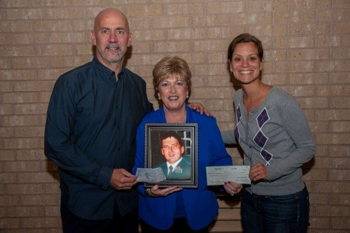 Pictured from left are Kevin Pieper, Salem Missions Director; Paula Whitaker, Trustee of Ryan Whitaker Memorial Foundation; and Jenny Honeck, Children Caring for Children in Africa Sponsor.