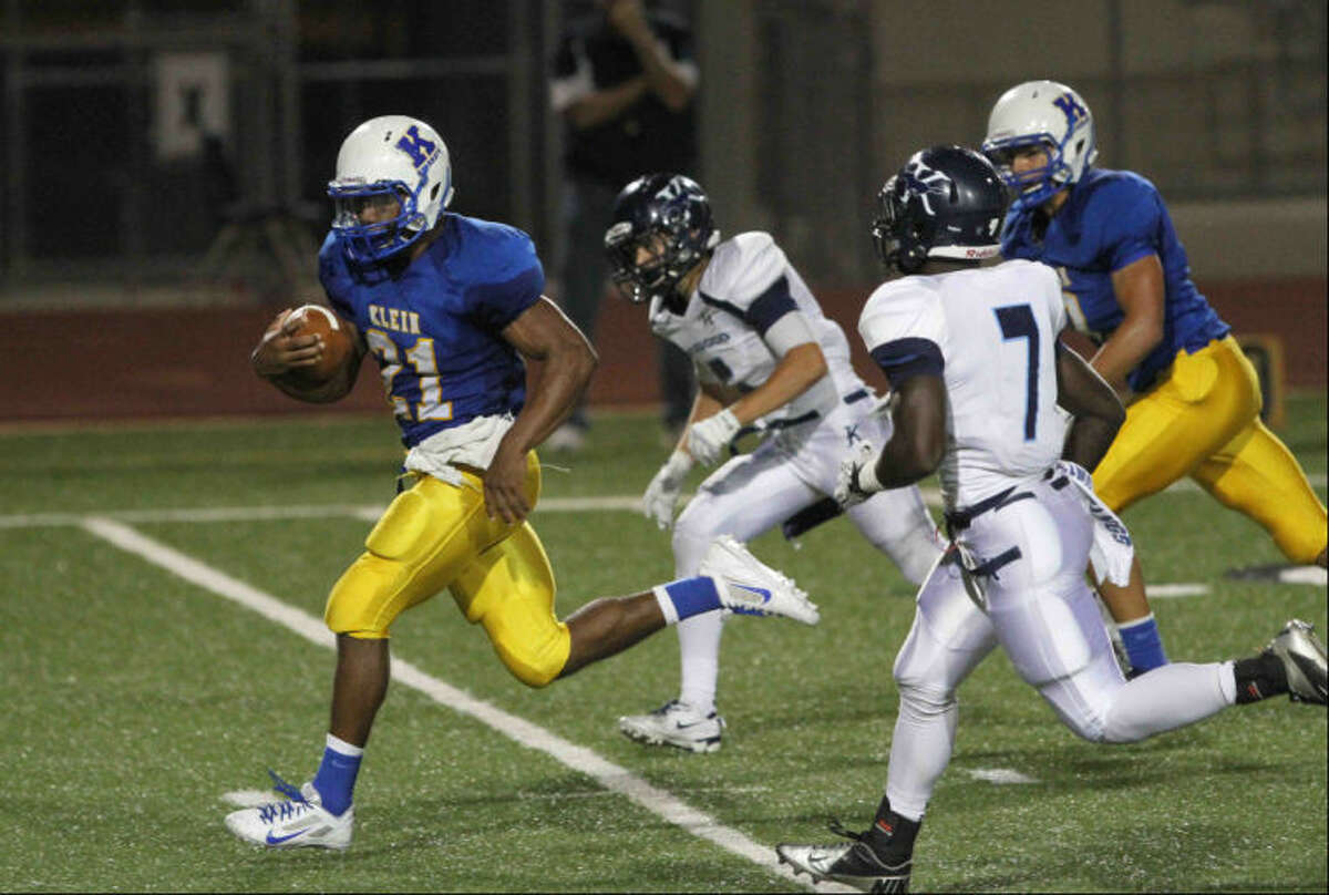 Klein running back David Hamm (21) scores a touchdown during a District 13-5A football game at Klein Memorial Stadium Thursday. Klein defeated Kingwood 49-21.
