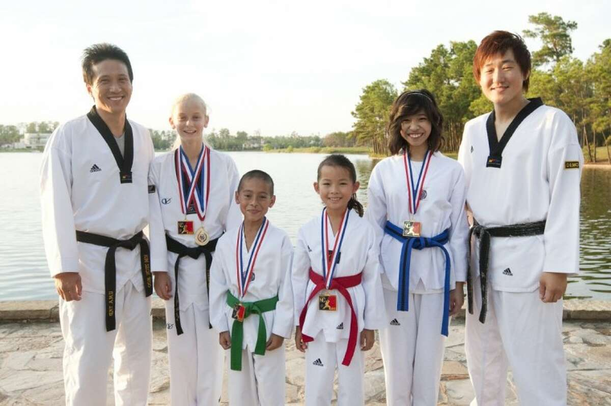 2012 USA Taekwondo National Champions pose with their medals. From left to right: are Master Kim, Danielle Wassell, Angel Bertin, Hayley Jue, Hannah Miranda and Master Seo.