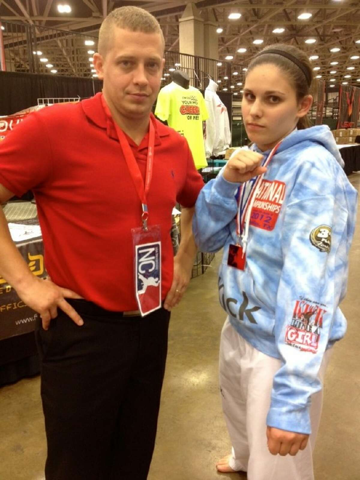 Julia Glandt, eighth grader at McCullough High School, poses with Taekwondo coach Bill Gibbs after receiving bronze in sparring at the USAT National Championships in July in Dallas.