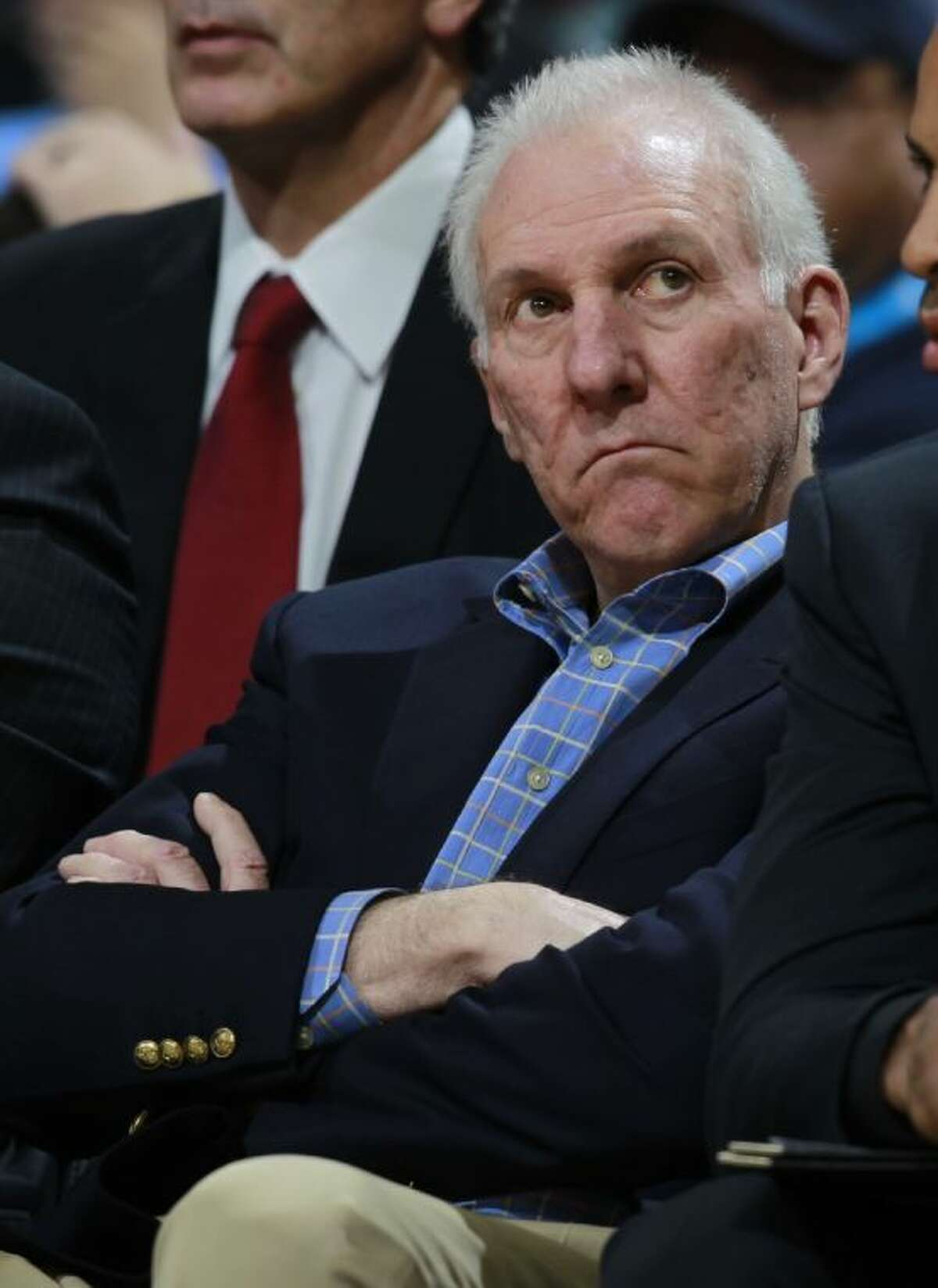 San Antonio Spurs coach Gregg Popovich reacts as he checks the scoreboard as time winds down in the fourth quarter of the Denver Nuggets' 98-94 victory over the Spurs in a preseason game on Oct. 14 in Denver.