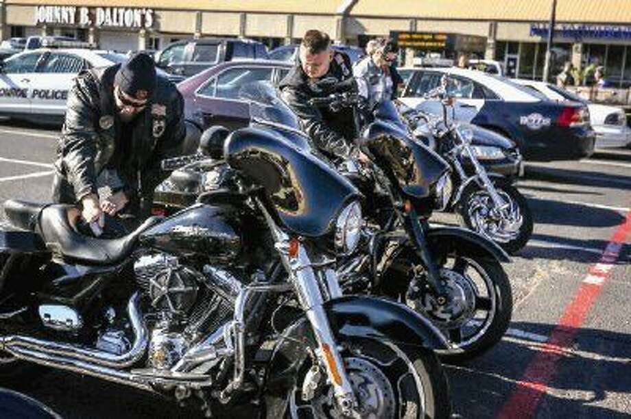 Bikers from Pipe Hitters Union, Iron Syndicate, Rough Riders and the Marine Corps prepare for a motorcycle ride during the fundraiser for the Salvation Army Angel Tree program on Saturday, outside of Maverick's Saloon. Photo: Michael Minasi