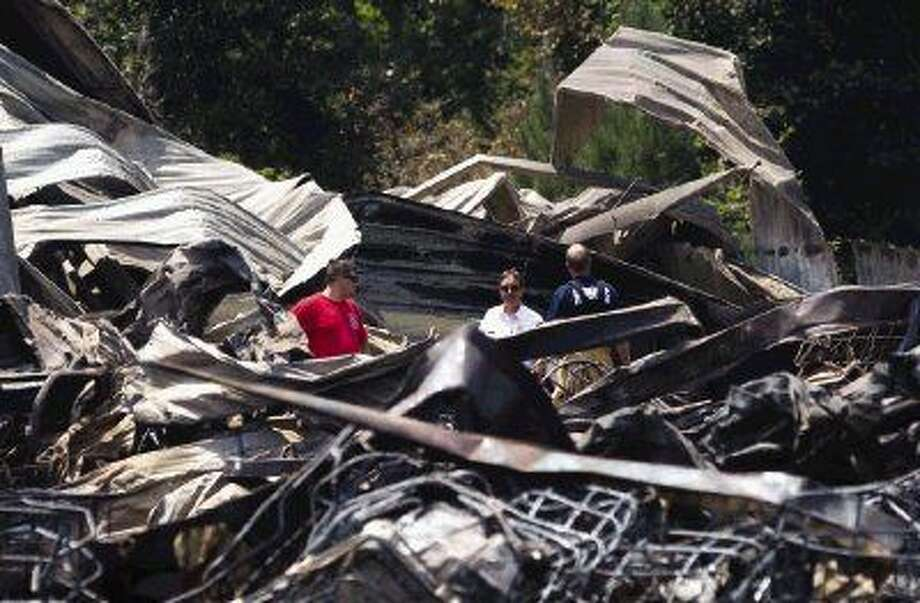 Montgomery County officials investigate the scene of a chemical explosion at DrillChem in Conroe. Photo: Jason Fochtman