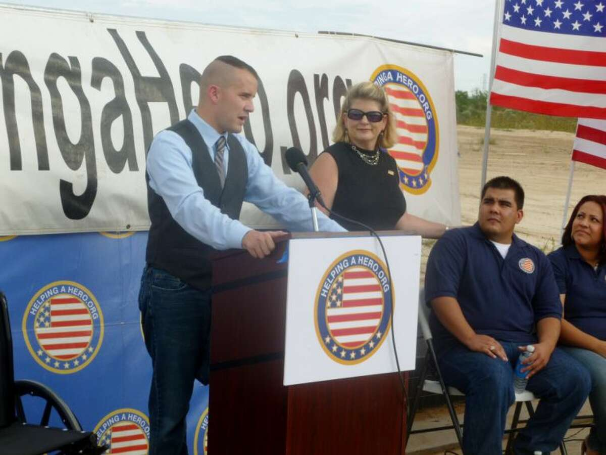Helping a Hero Executive Director Brandon Byers discussed Helping a Hero during a groundbreaking ceremony for veteran Raul Olivares' new home in Cypress.