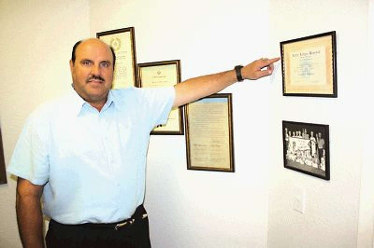 Dr. David Higginbotham points to one of the memories on his office wall from that special summer 40 years ago. A pitcher and outfielder for the 1972 Pan American Little League all-stars, Higginbotham helped the team to a 13-game winning streak that had the squad come within 12 innings of going to the Little League World Series. Behind him are proclamations from then Governor Chet Brooks and a city proclamation.