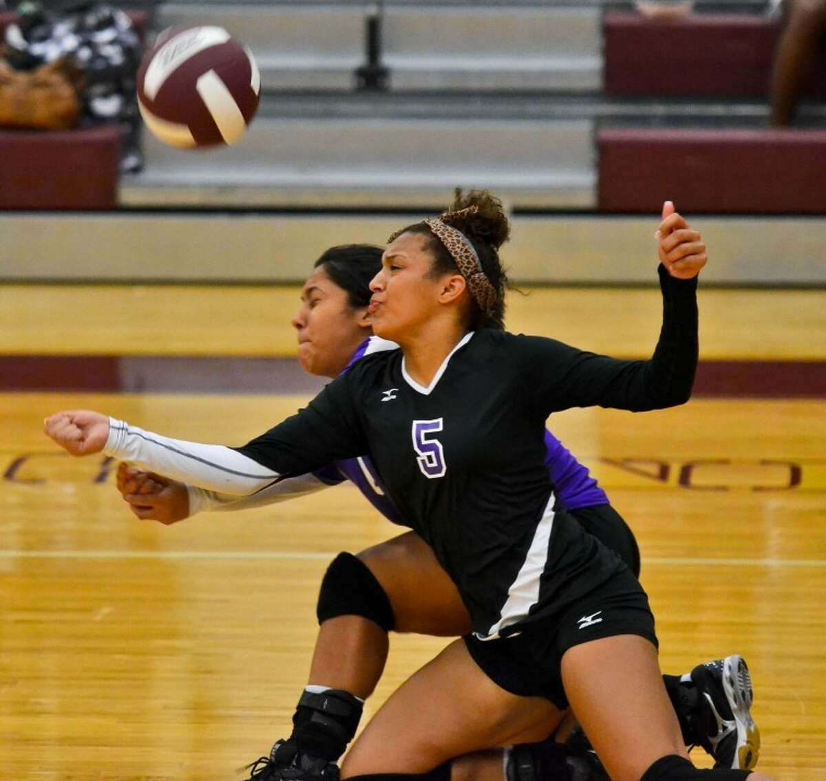 Jasmine Bledsoe (5) and Jackie Enriquez both dive to return a serve in the third game of Humble's 3-0 loss at Summer Creek Sept. 11.