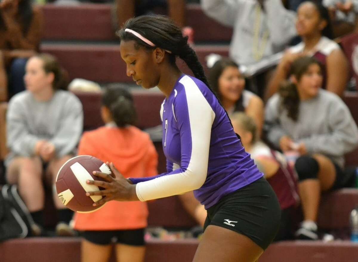 Chauncenique Rushing prepares to serve in the first game of Humble volleyball's 3-0 loss at Summer Creek Sept. 11.