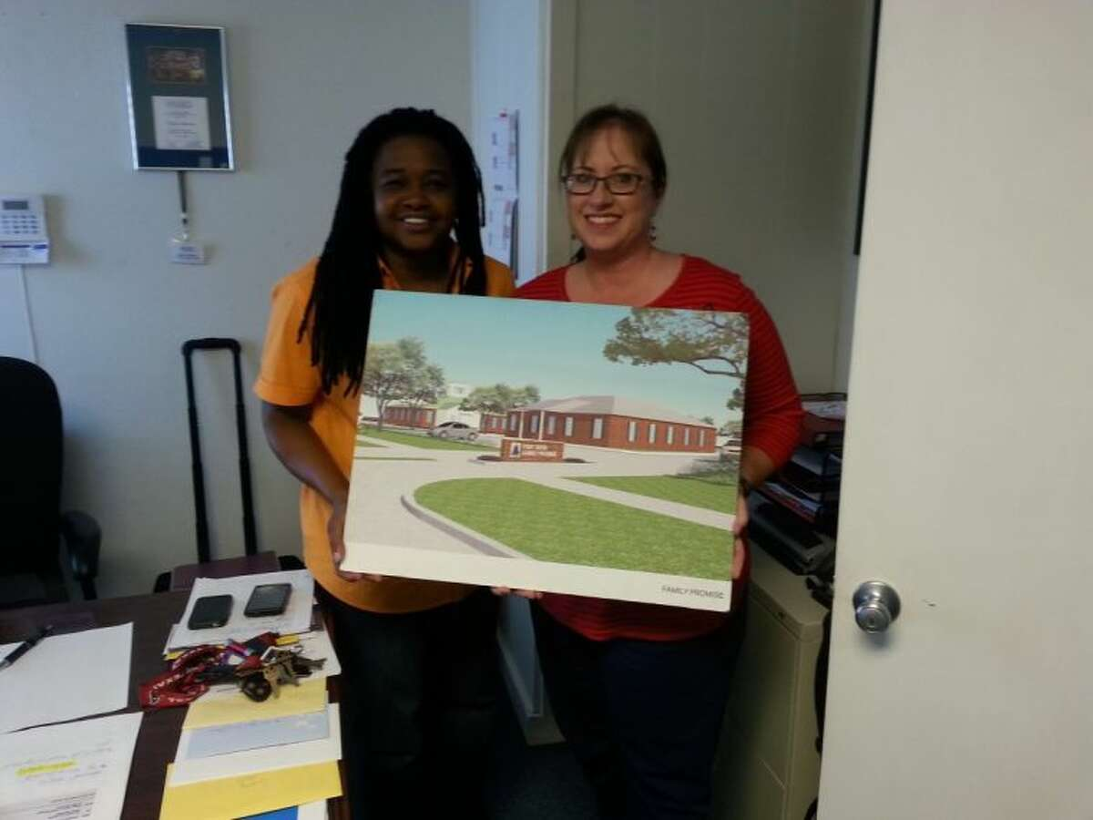 Fort Bend Family Promise Executive Director Vera Johnson (left) and Trustee Robbin Mallett with a computer rendering of the FBFP's new Day Center, to be constructed at Cartwright Road near Dulles Avenue.