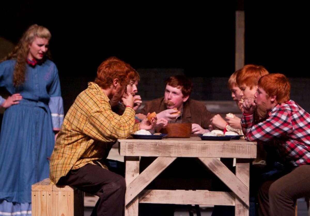 Left, Mary Robbins, 13, a student at Knox Junior High, tries to give some manners to the rowdy brothers in a scene from Christian Youth Theater's production of