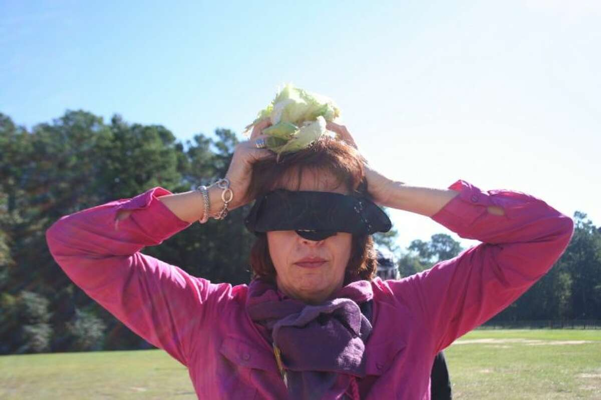 Bear Branch fifth grade teacher Susan Rasmussen holds a head of lettuce on her head in a ploy by the knights at the Tournament of Champions.