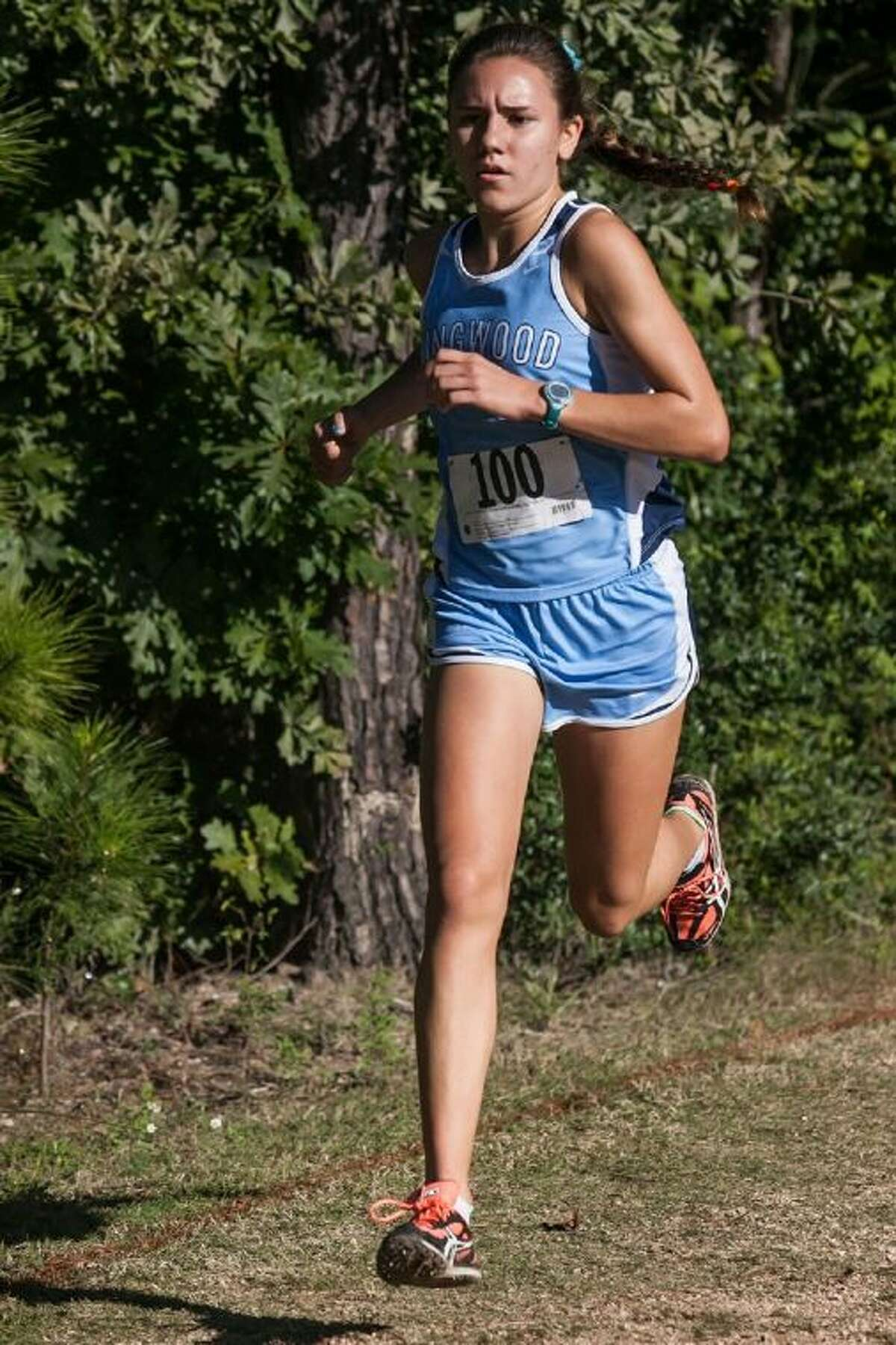Kingwood's Abby Guidry hustles to the finish line at the District 13-5A girls cross country championships on Wednesday.