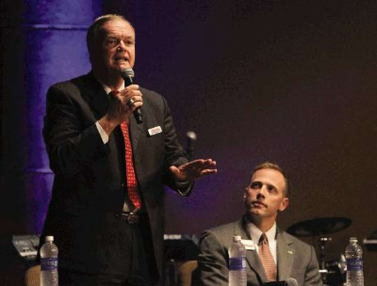 Railroad commissioner candidate Wayne Christian gives his opening remarks during a statewide Republican primary debate at Grace Community Church in Spring Thursday.
