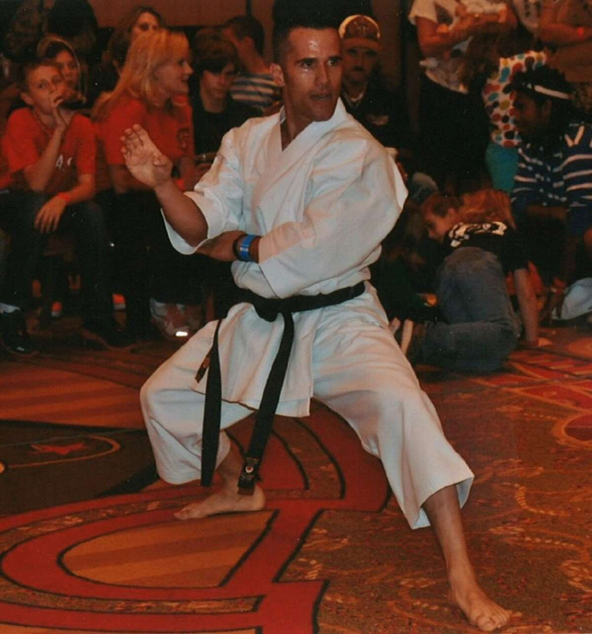 Alfredo Bustamante, a 35-year-old Cypress resident, earned the Triple Crown Title by placing first in three different events at the International Congress of Martial Arts Tournament earlier this month in the Dominican Republic.