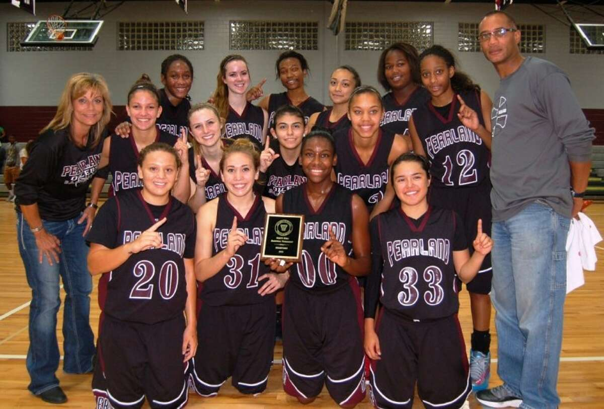 The Pearland Lady Oiler basketball team went undefeated this weekend in the 2012 Lady Gander Tip-Off Classic in Baytown. They made it through bracket play with victories over Channelview, Barbers Hill and Kingwood before defeating Atascocita, 50-36, in the championship game. Team members are (back row left to right) Jasmine Butler, Elyse Bell, LaNeetra Guillory, Savannah Kuon, Kaila Chizer (middle row) head coach Donna Vacek, Sierra Morish, Stacey Barnett, Alexis Rodriguez, Journey Hawkins, Taylor James, assistant coach Andre Stokes (front row) Miranda LeJune, Chelsea Cervantes, Keara Hudnall and Nikki Valencia.