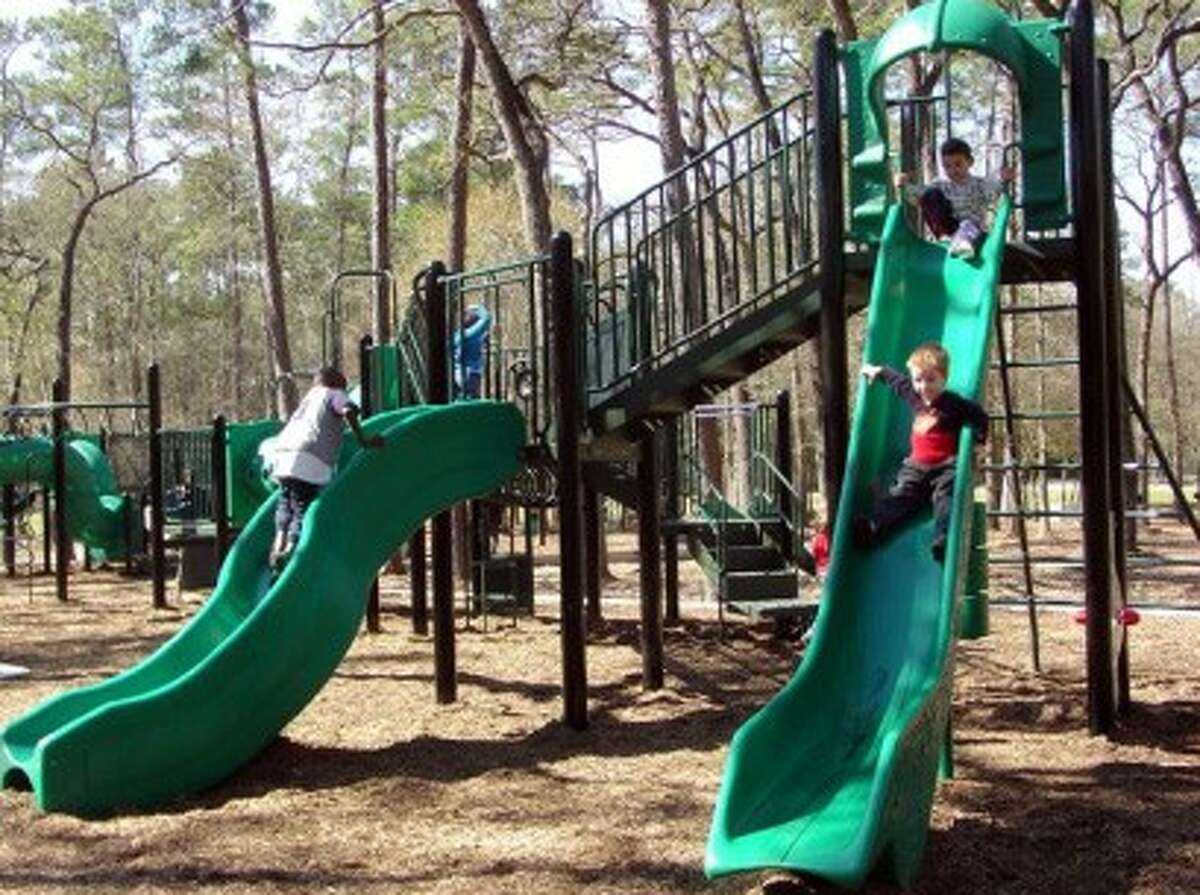 Mercer Arboretum and Botanic Gardens has a playground appropriate for children ages 6 through 12.
