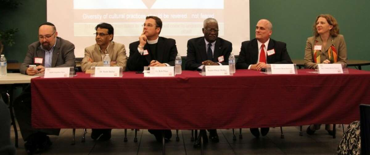 Panelists for Klein ISD's Unite for Understanding include, from left, Rabbi Jonathan Siger from the Congregation Jewish Community North; Dr. Sashi Bellur, a Hindu practicing cardiologist; Father Rob Price of St. Dunstans Episcopal church; Pastor Oscar Walker of the non-denominational Disciples Tabernacle Church; President Brent Rawson from the Church of Jesus Christ of Latter-day Saints (Mormon); and The Rev. Ginny Brown Daniel from the Plymouth United Church.