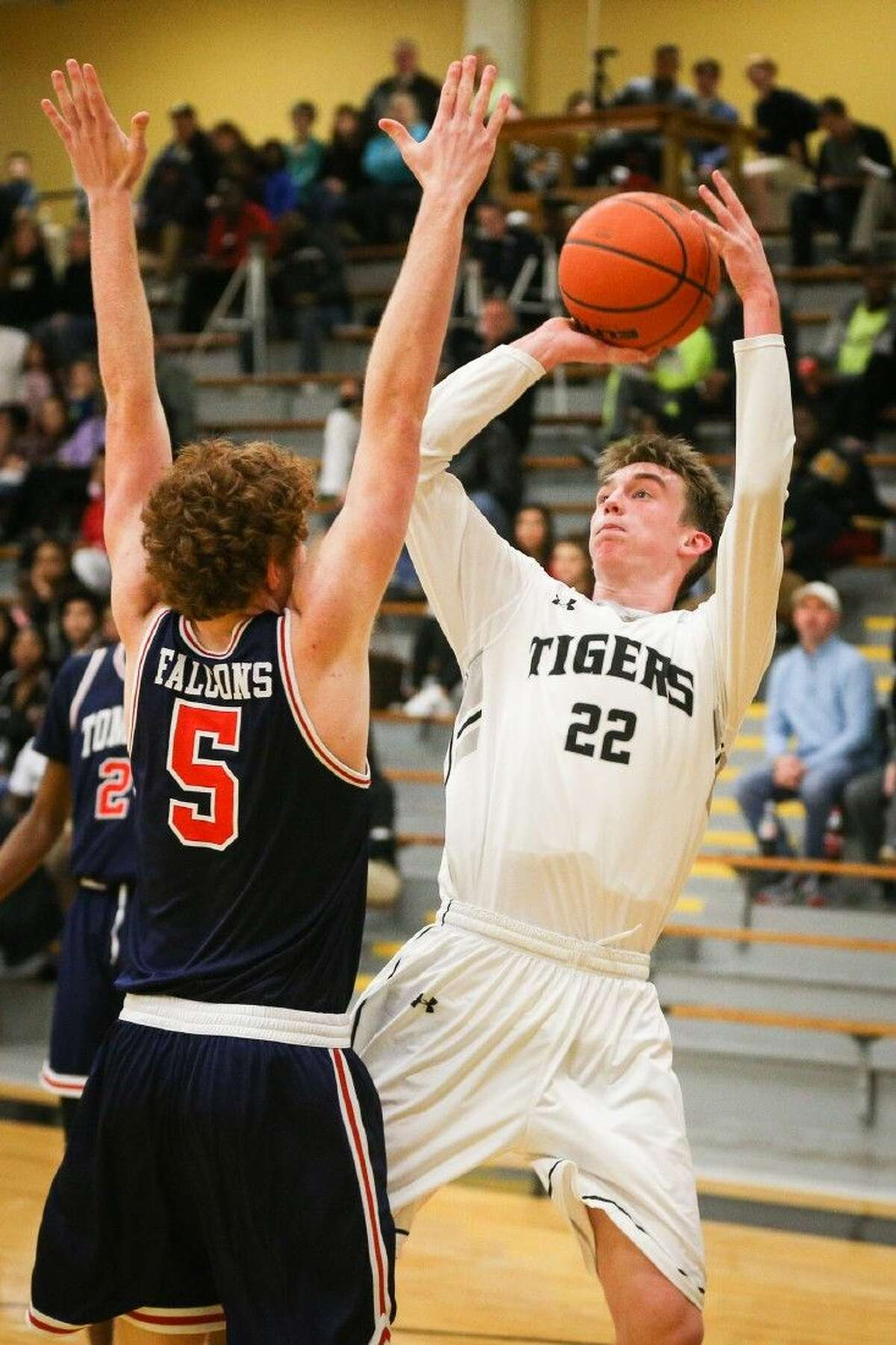 Conroe's Blaine Alger puts up an outside shot in the Tigers' 64-48 victory over Katy Tompkins. To view more photos from the game, go to HCNPics.com.