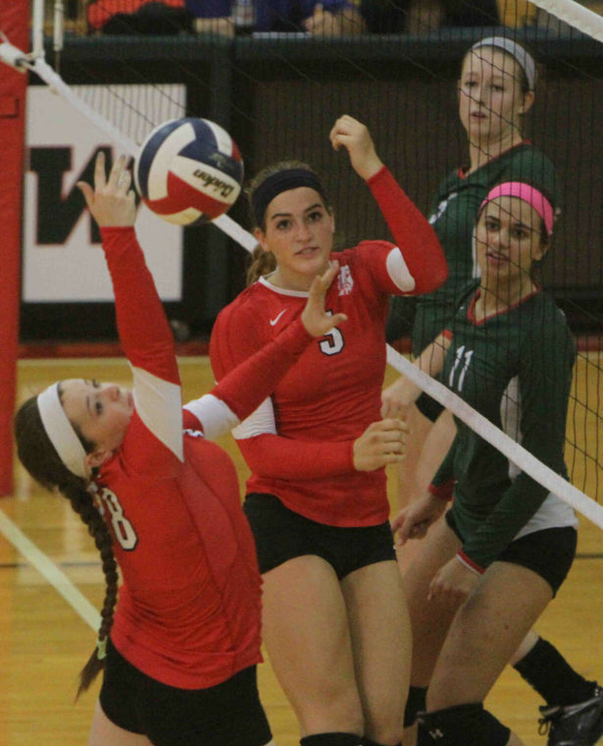 Katy's Madison McConnell looks on as Katy's Emily Shafer tries to regain control of the ball during a non-district match at The Woodlands High School. The Lady Tigers can win a share of the District 19-5A championship with wins in their last two matches.