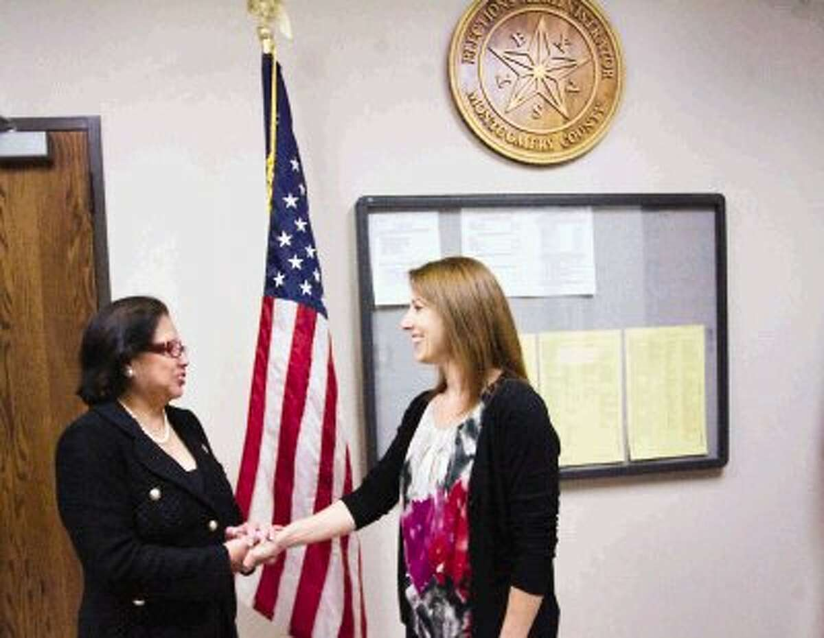 Texas Secretary of State Hope Andrade, left, chats with Suzie Harvey, Montgomery County elections administrator, after touring Montgomery County Election Central in Conroe.