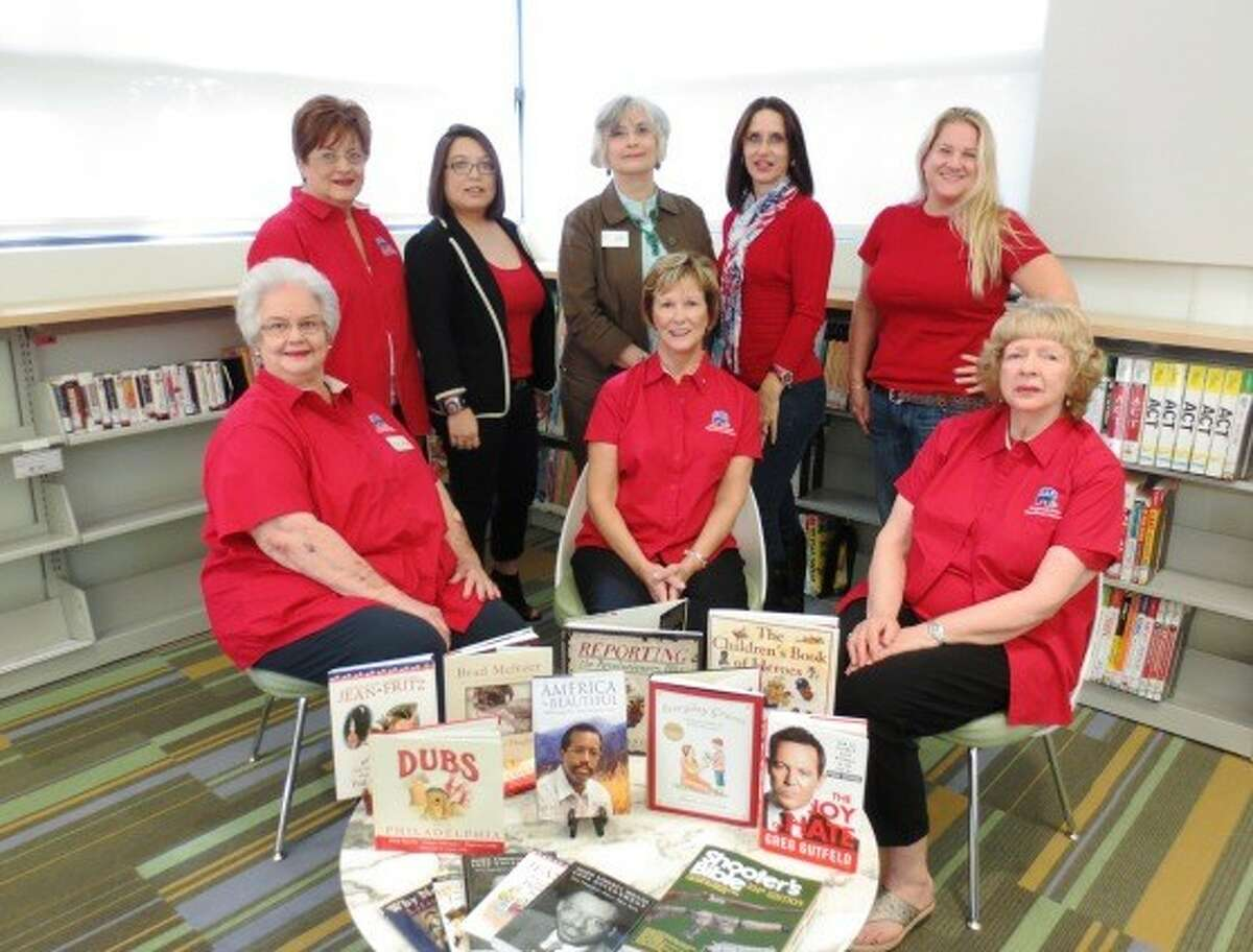 The Kingwood Area Republican Women who were a part of the book donation project are standing, from left, Barbara Jordan, Cherri Ledoux, Christi Whittington (Branch Librarian), Denise Krieger and Wendy Alexander and seated, from left Anne Wallace, Carol Covey and Betty Newton.