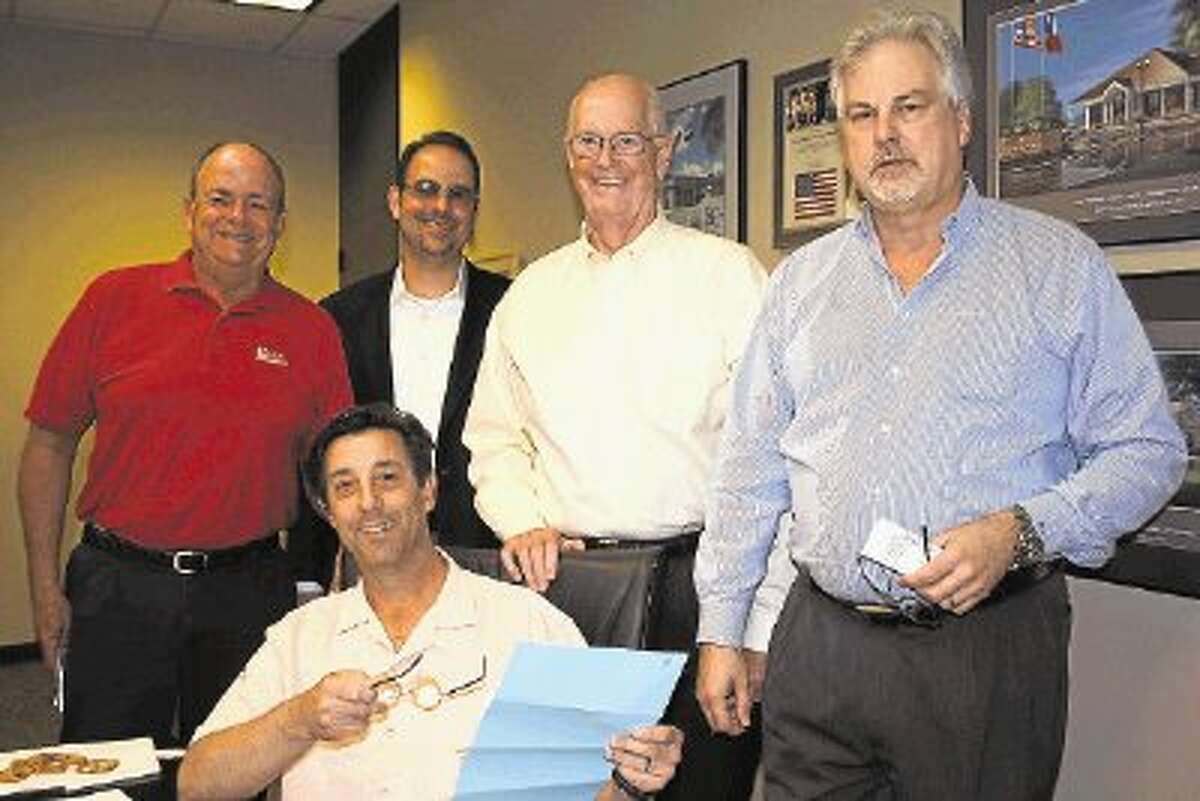 Shrimporee Chairman Scott Rainey, seated, hands out work assignments for the Oct. 26 Space Center Rotary event to Rotarians Alan Wylie, Jorge Hernandez, Jerry Smith and Mark Pollard, from left, at recent planning meeting.