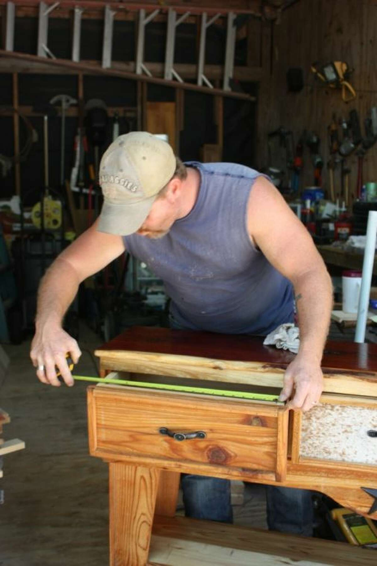 Mike Darnell works every day of the week building custom woodwork and selling his products on the roadside, at rodeos and festivals. His attention to detail on the solid wood pieces keep customers coming back to shop.