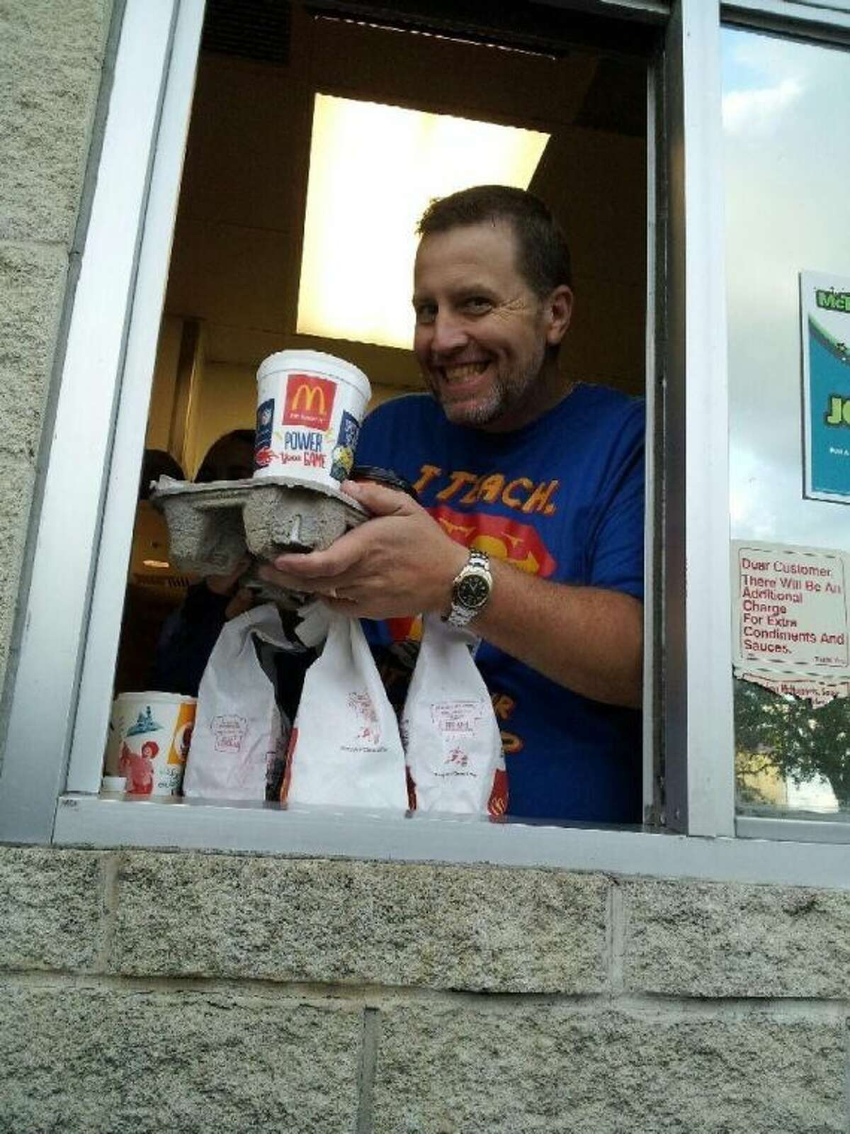 Southside Principal Preston Wenz serves as the drive-thru person for the Cleveland McDonald's on Oct. 10 during McTeachers Night.