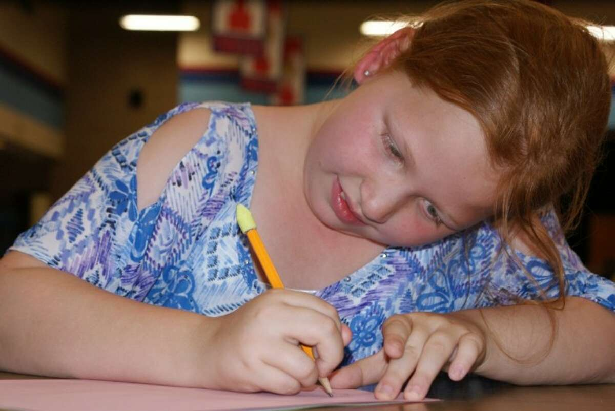 Emma Yurko is dedicated to making bookmarks to help raise money for cancer charities.