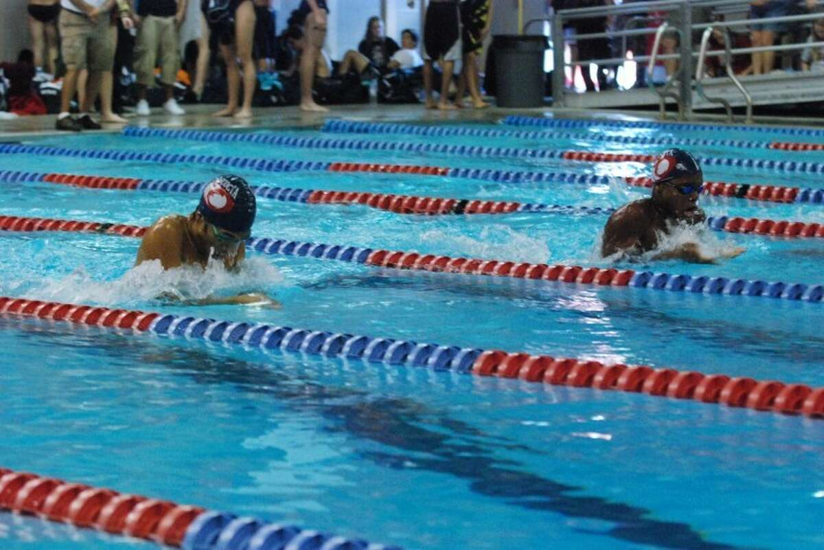 Matt Parel and Chase Thompson swim in the 100 meter breaststroke at the Atascocita Early Bird Invitational.