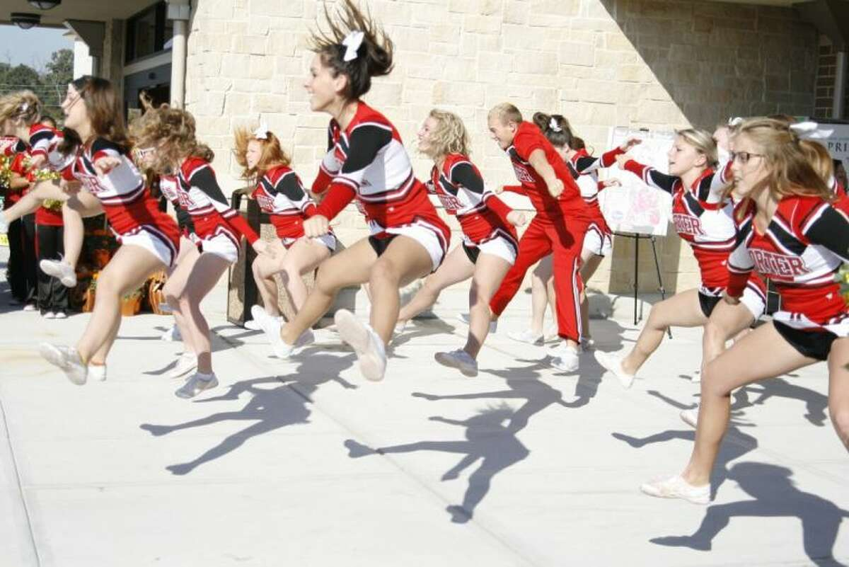 Porter High School Spartan cheerleaders entertained guests at the opening of the Kroger Marketplace Oct. 26, 2013.