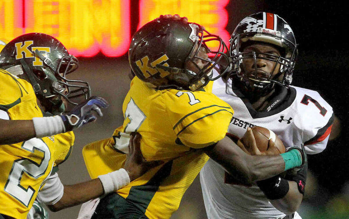 Westfield quarterback Courtland Greenwood gets tackled by Klein Forest defensive back Tavaris Jones during a high school football game at Klein Memorial Stadium Thursday. Westfield defeated Klein Forest 31-17. Go to HCNPics.com to view more photos from the the game.