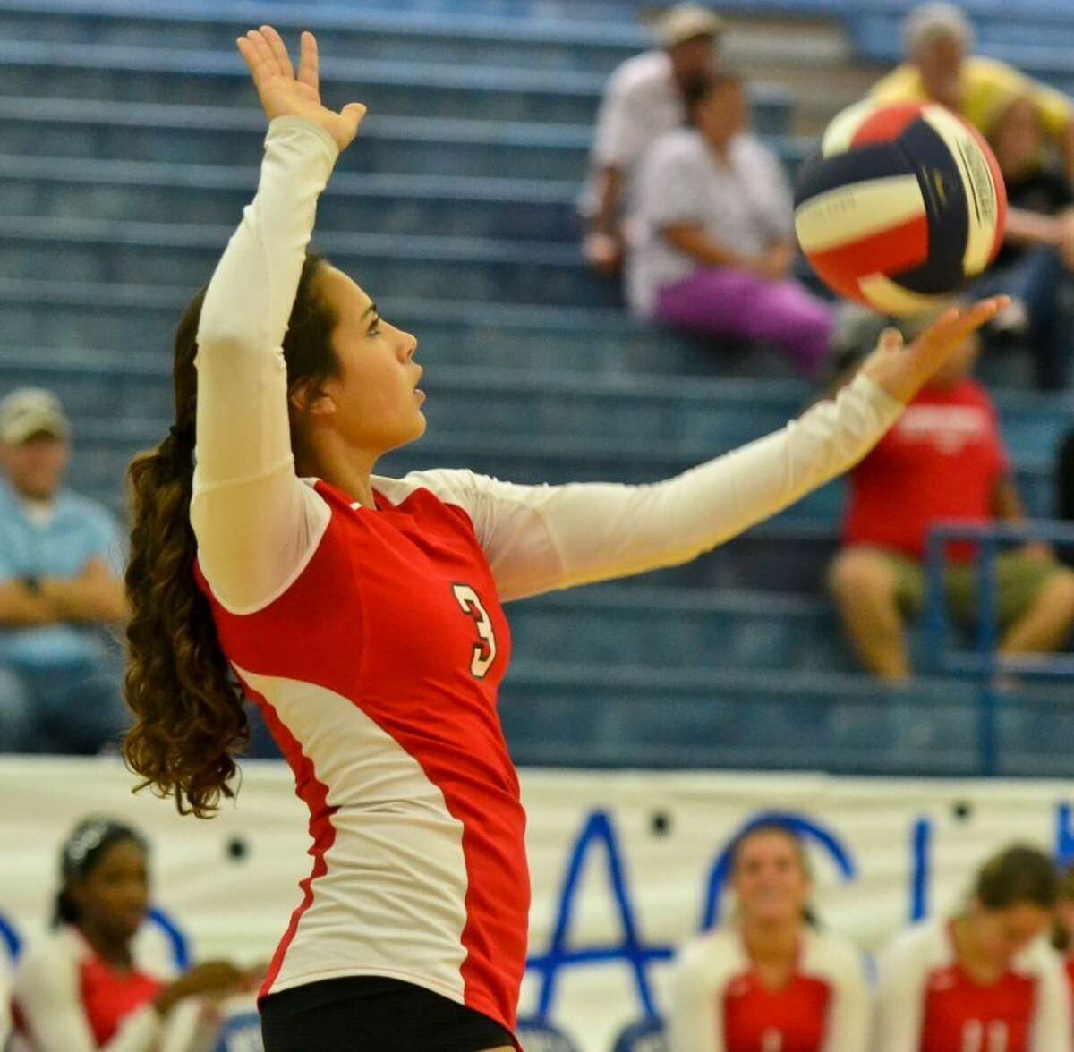 Kaemen Alonzo prepares to serve in the first game of Crosby's 3-0 win at New Caney Sept. 4.