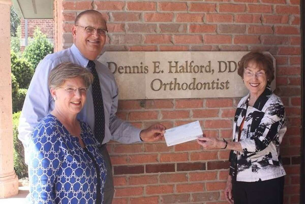 Sugar Land residents Dr. Dennis and Lynn Halford present Charlene Pate, Fort Bend Children's Discovery Center Co-Chair, with a contribution of 25,000 to the museum. The Halford's contribution will be recognized on a column in the museum's entry.