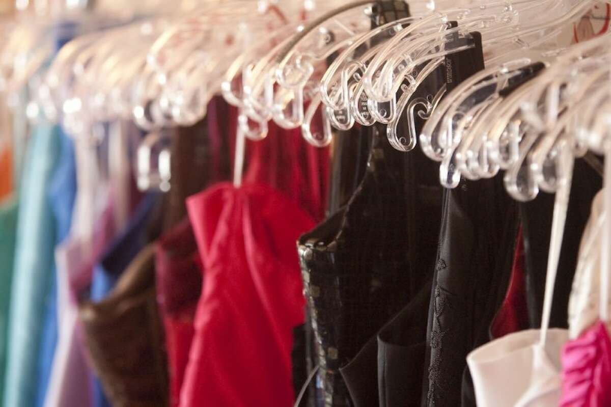 Dresses hang in the Formal Dreams Foundation Boutique in Magnolia.