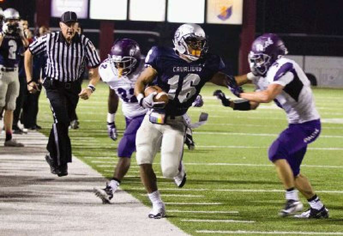 College Park running back Nicholas Black runs with the ball against Lufkin during a game Friday night at Woodforest Bank Stadium. Go to HCNPics.com to view and purchase this photo, and others like it.