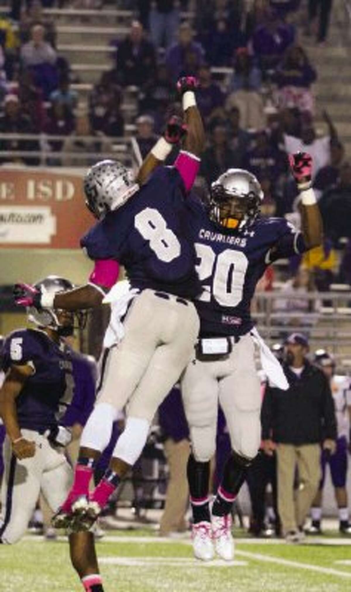 College Park defensive back Eric Harrell (8) and Cavalier defensive back Stephan Johnson (20) celebrate after a play against Lufkin Friday night.