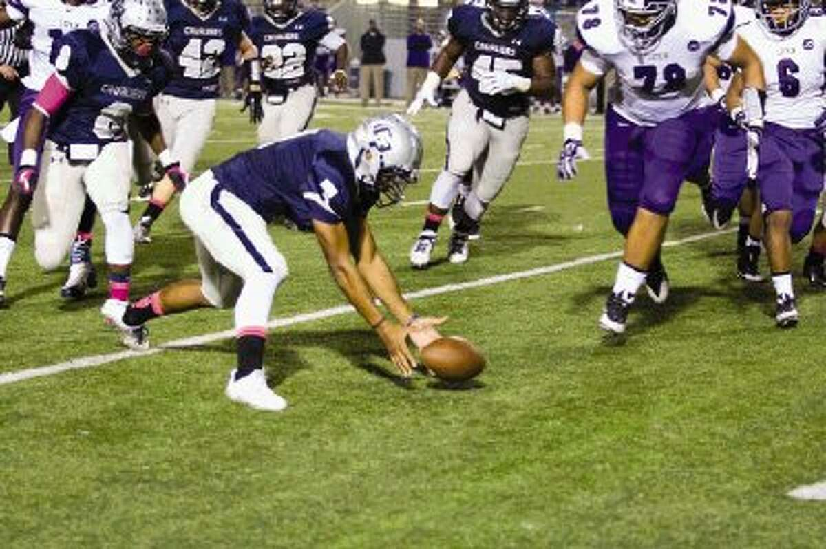 College Park defensive back Alexander Myres tries to take control of a fumbled ball during a game against Lufkin Friday night. Go to HCNPics.com to view and purchase this photo, and others like it.