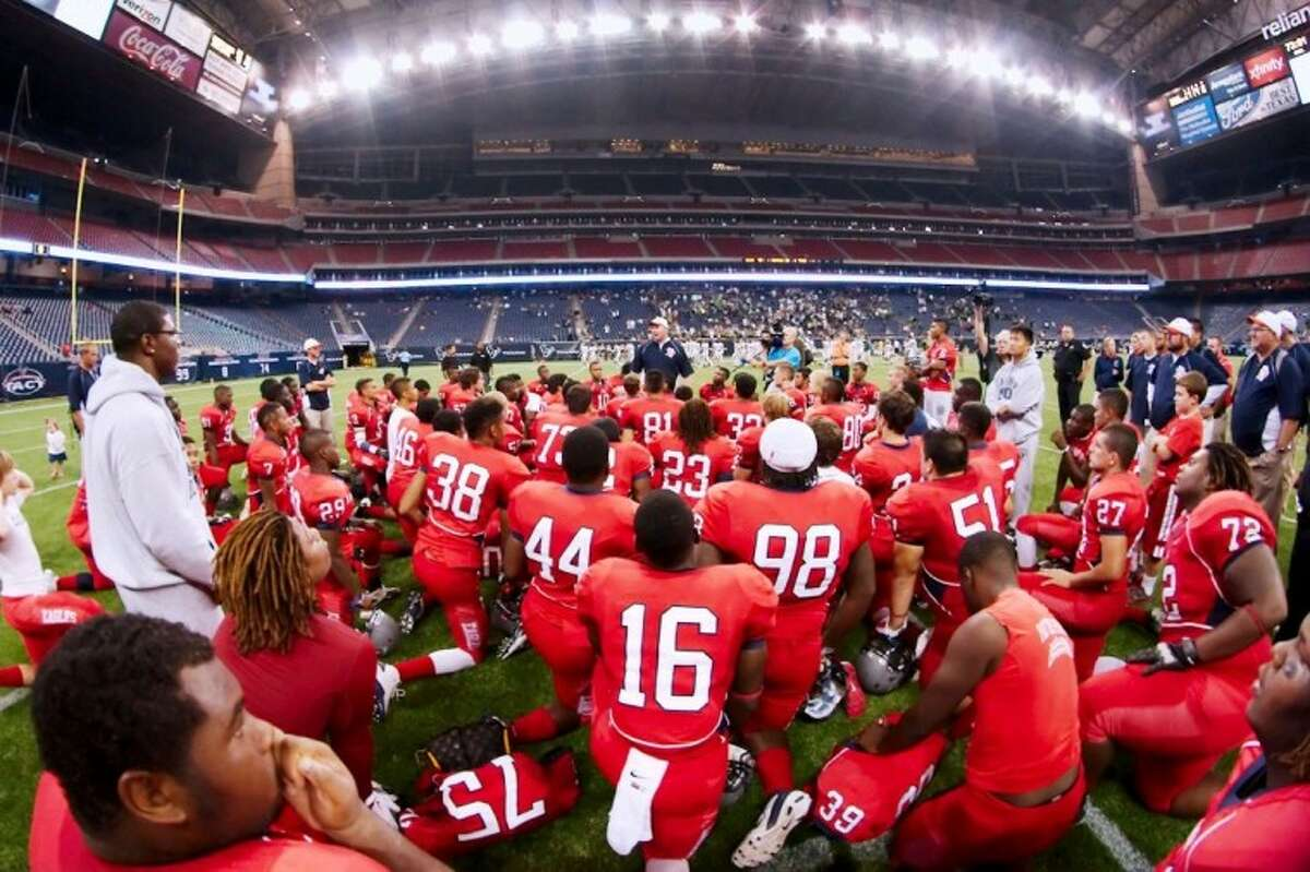 Dawson head coach Eric Wells talks to his team after its 48-35 win over Houston Stratford Friday in Reliant Stadium. The Eagles take on Nederland next week in the regional quarterfinals.