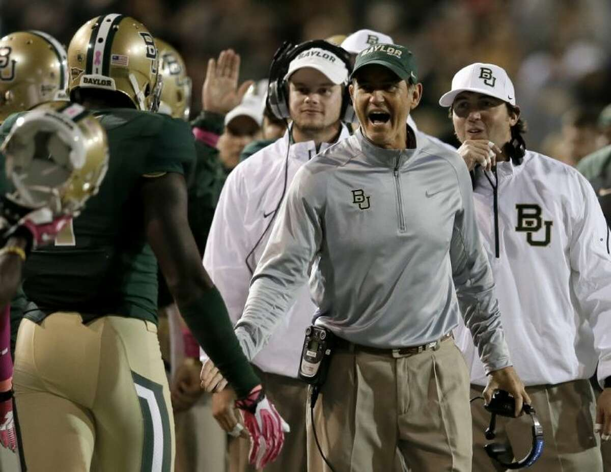 Baylor coach Art Briles congratulates players as they walk off the field following a score against Iowa State on Saturday in Waco.