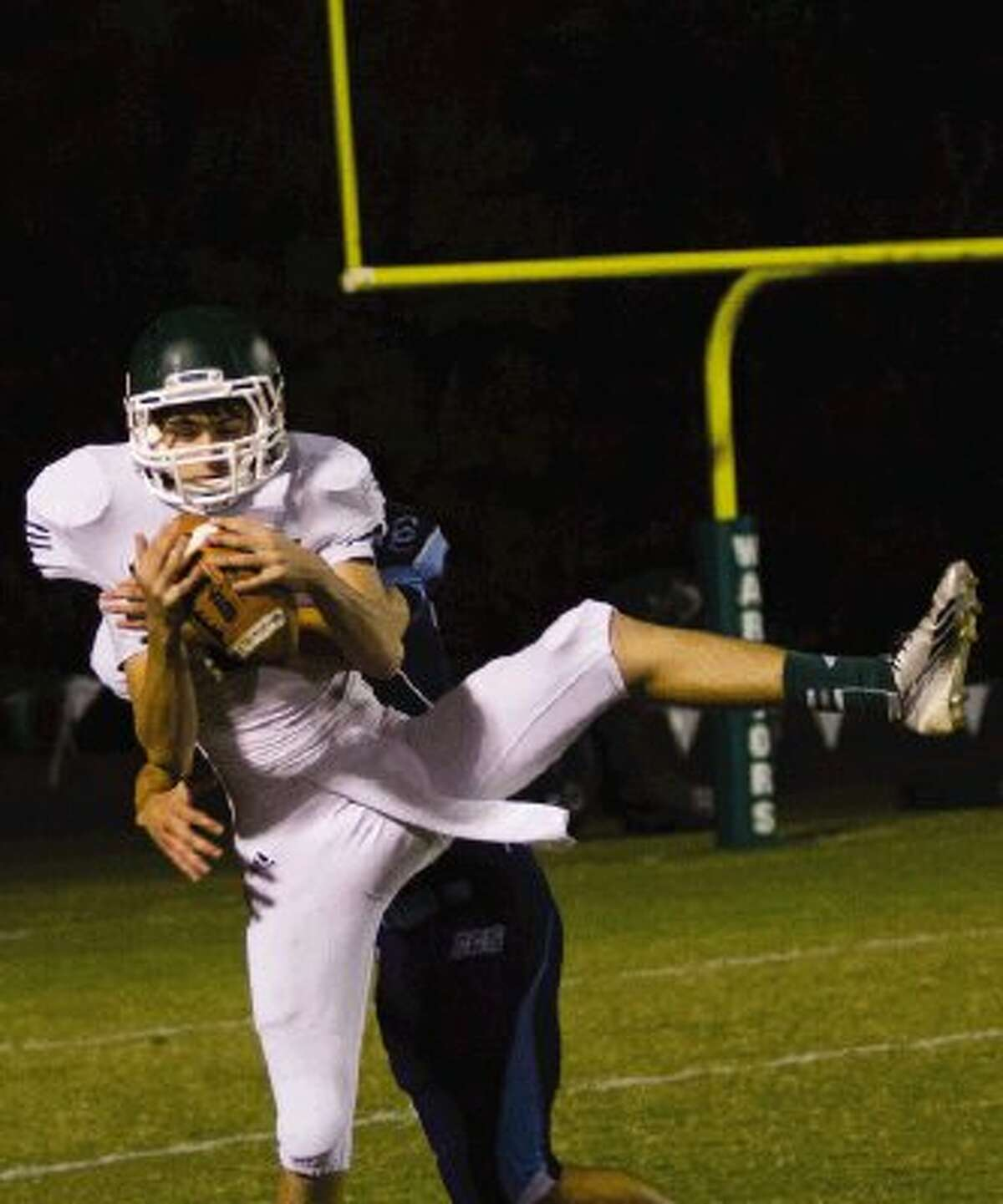 The Woodlands Christian's Calvin Thedinger catches a pass during a game against Cypress Christian on Friday night at The Woodlands Christian Academy. To view or purchase this photo and others like it, visit HCNpics.com.