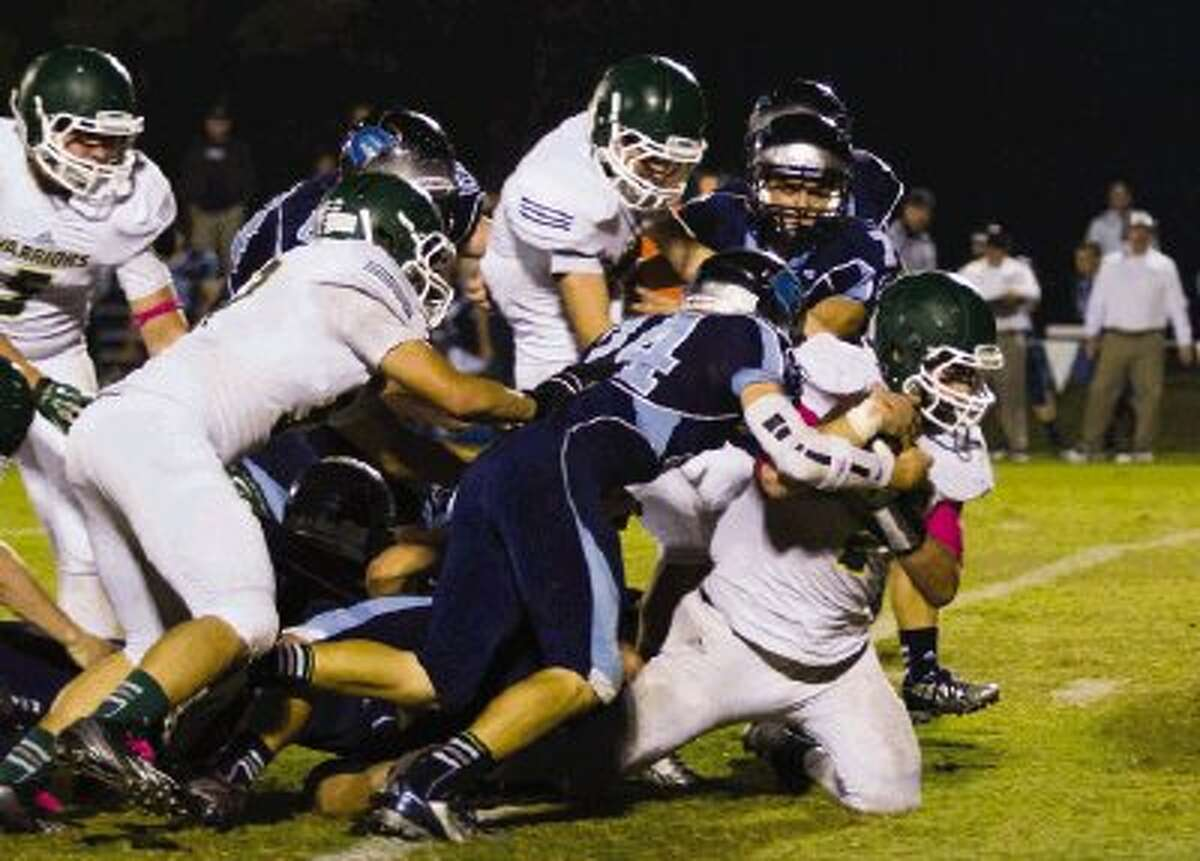 A Cypress Christian defender tackles The Woodlands Christian's Michael Sacks on Friday night at The Woodlands Christian Academy.To view or purchase this photo and others like it, visit HCNpics.com.