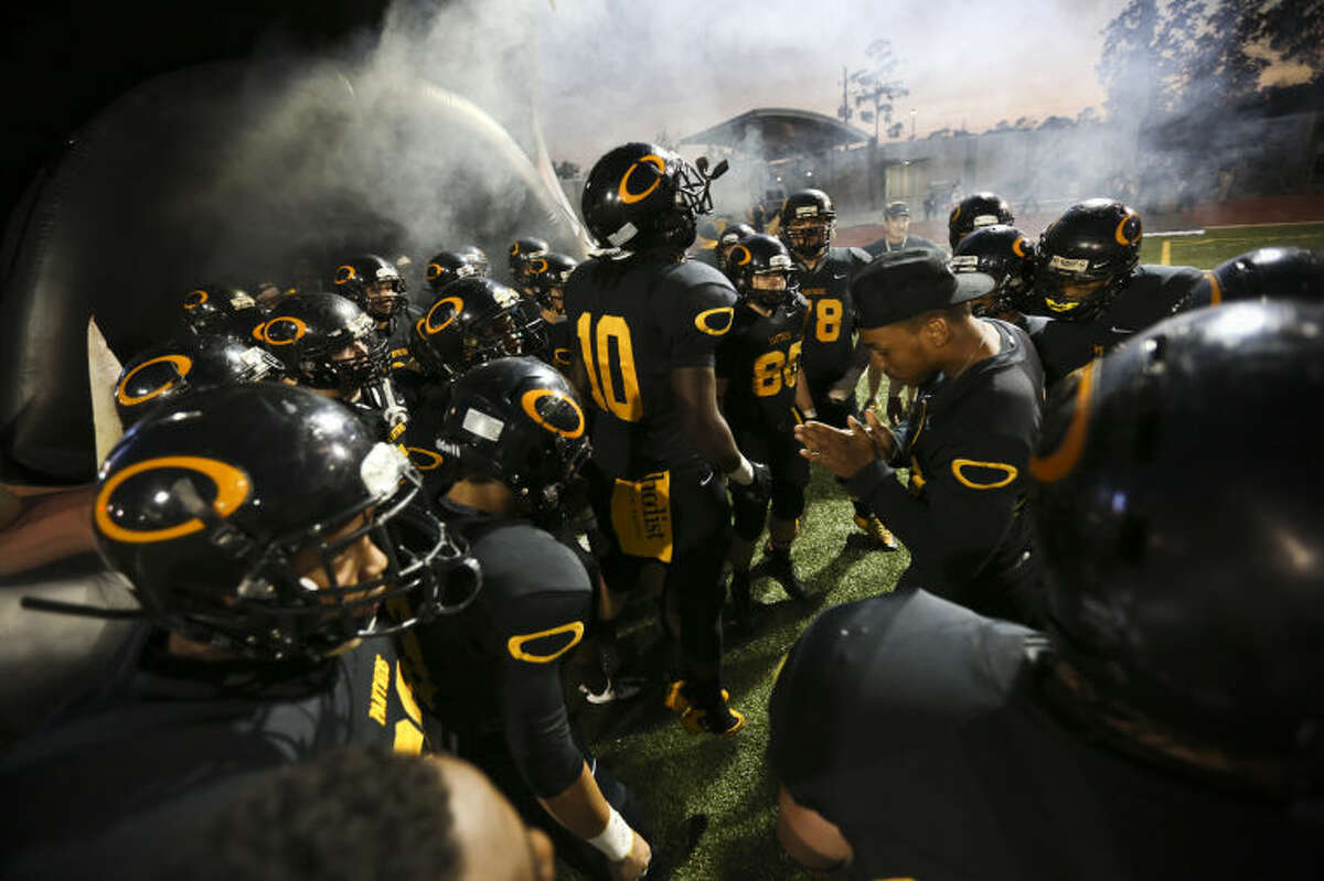 The Klein Oak Panthers get pumped before the start of the game against Spring on Friday at Klein Memorial Stadium. To view or purchase this photo and others like it, go to HCNPics.com. (Michael Minasi / HCN)