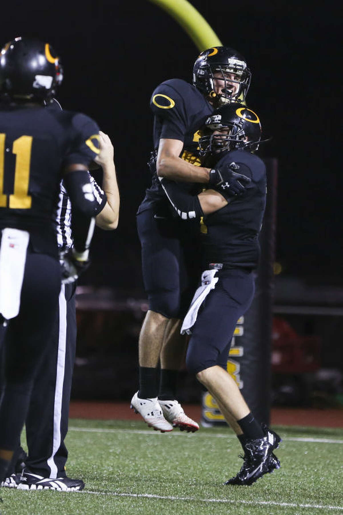 Klein Oak Panthers celebrate after scoring a touchdown during the game against Spring on Friday at Klein Memorial Stadium. To view or purchase this photo and others like it, go to HCNPics.com. (Michael Minasi / HCN)