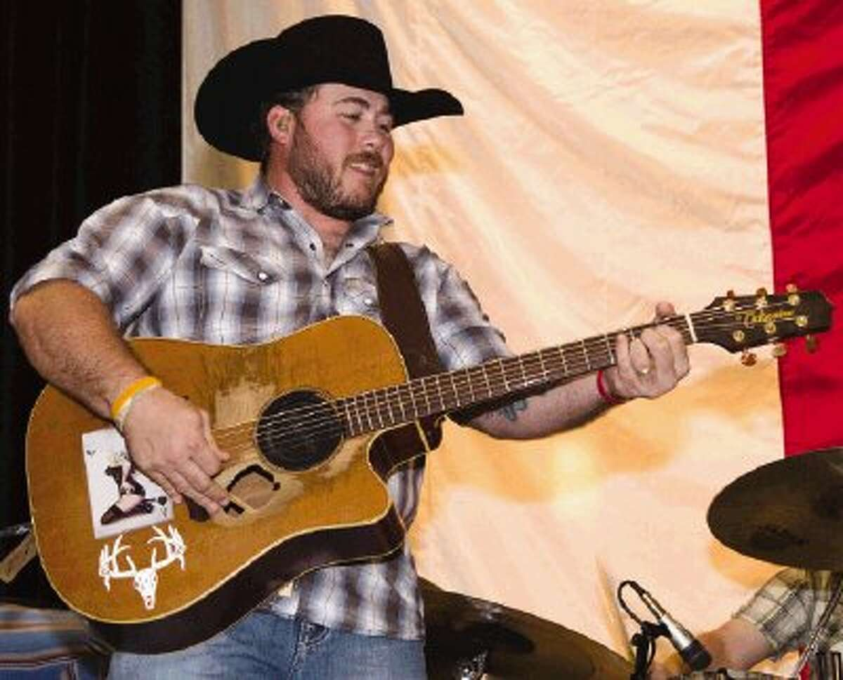 The Josh Ward Band plays during the Go Texan Dance held at the Lone Star Convention Center Saturday night. Proceeds from the event go toward The Houston Livestock Show and Rodeo for scholarships for students in the Conroe and Willis school districts. The event included dinner, live music and dancing.