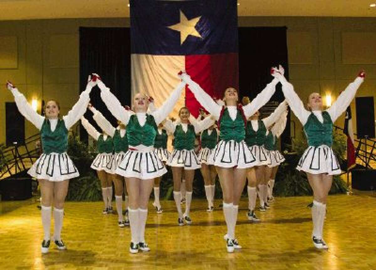 The Woodlands Highsteppers preform during the Go Texan Dance held at the Lone Star Convention Center Saturday night. Proceeds from the event go toward The Houston Livestock Show and Rodeo for scholarships for students in the Conroe and Willis school districts. The event included dinner, live music and dancing.