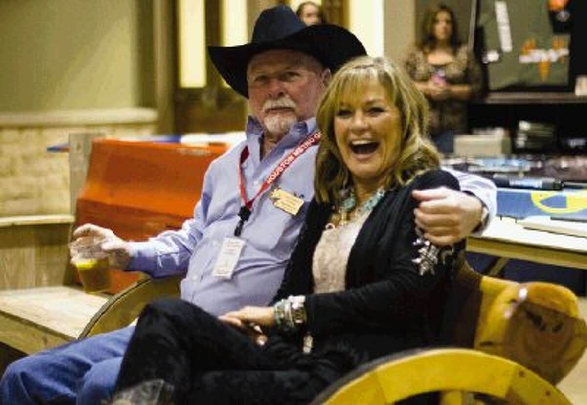 Larry Campbell and Theresa Howard mingle during the Go Texan Dance held at the Lone Star Convention Center Saturday night. Proceeds from the event go toward The Houston Livestock Show and Rodeo for scholarships for students in the Conroe and Willis school districts. The event included dinner, live music and dancing.