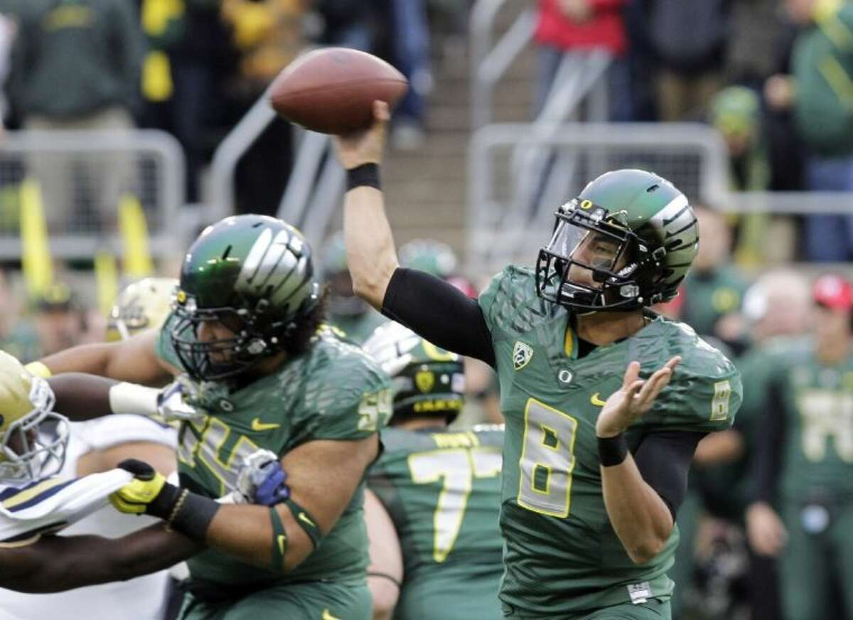 Oregon quarterback Marcus Mariota passes in the first half against UCLA. The second-ranked Ducks won 42-14.
