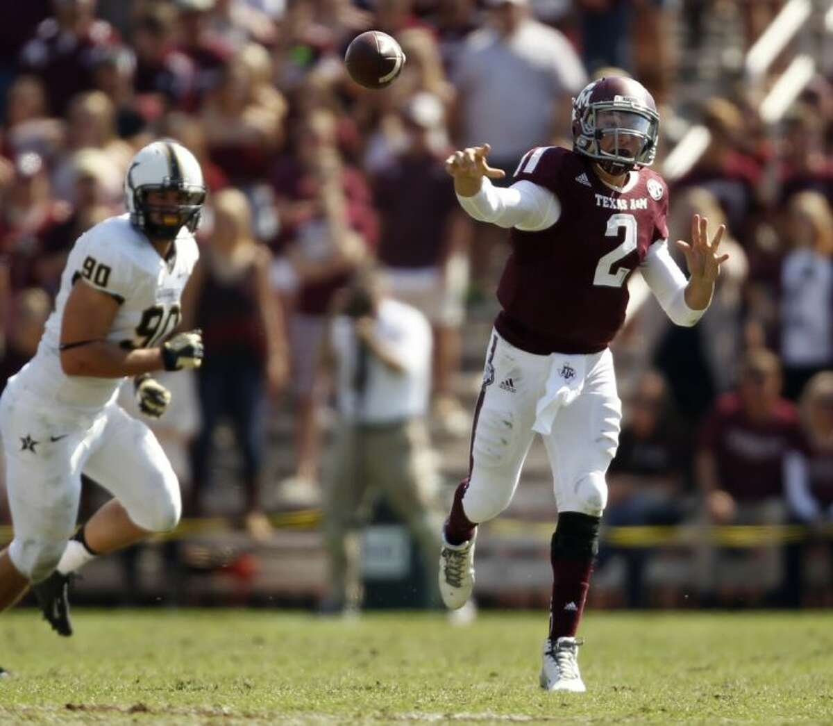 Texas A&M's Johnny Manziel throws a pass against Vanderbilt on Saturday in College Station. The Aggies won 56-24.
