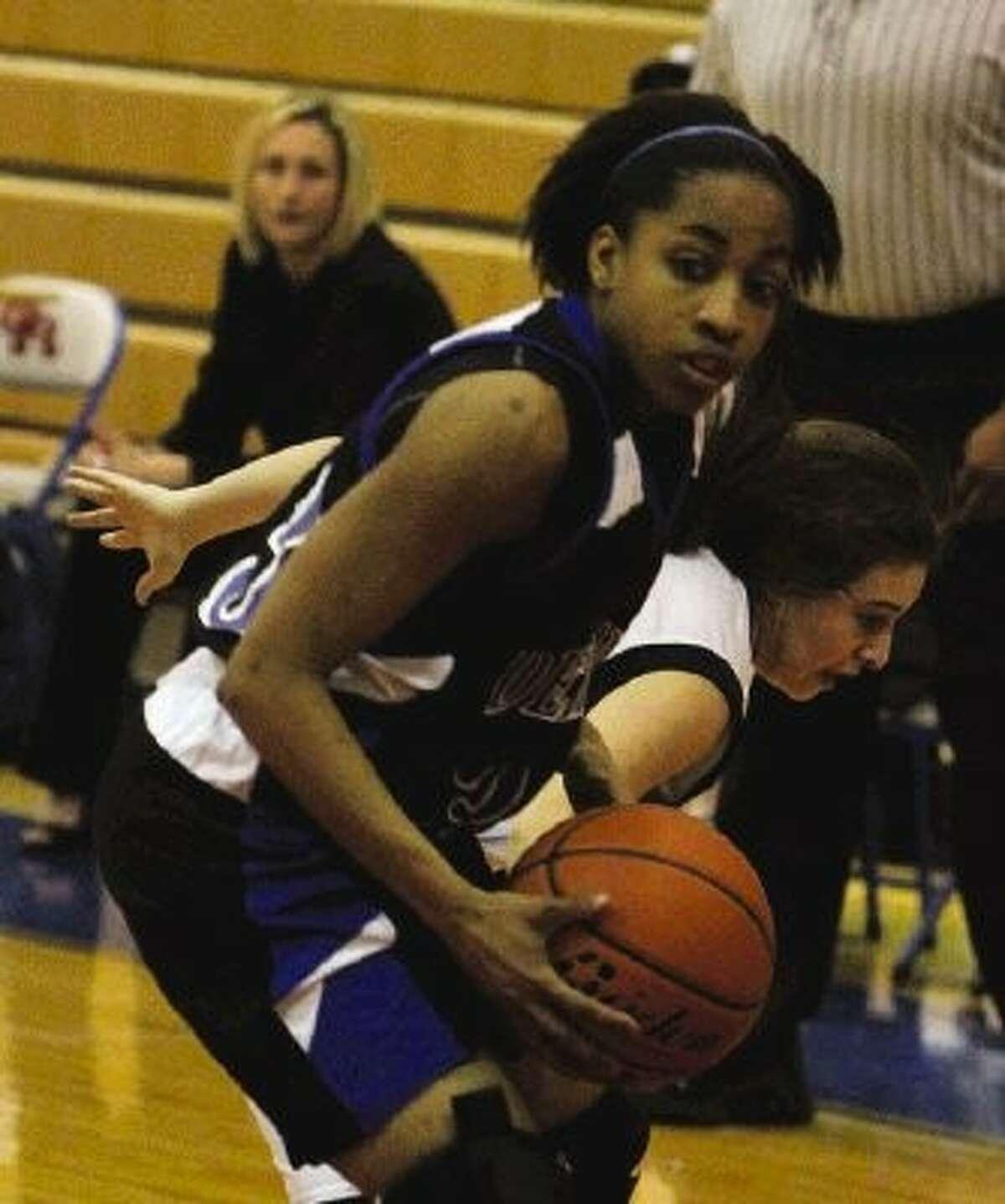 Dekaney's Kayla Nevitt (23) gets past a Kingwood defender for an easy basket during the girls basketball bi-district playoff game at Oak Ridge High School on Feb. 13.